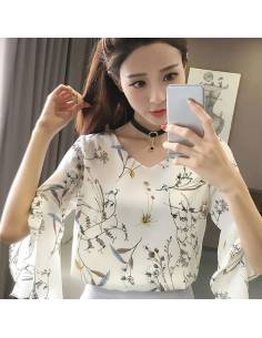Top floral manches papillons